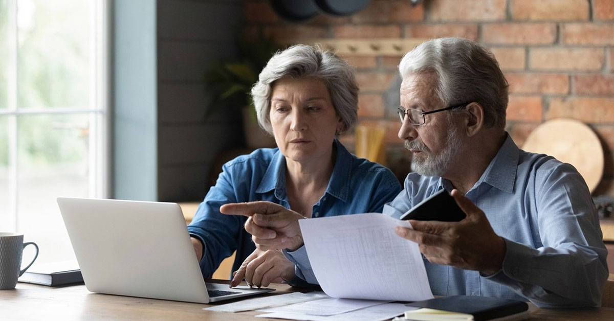A couple comparing printed tax information to their digital tax records
