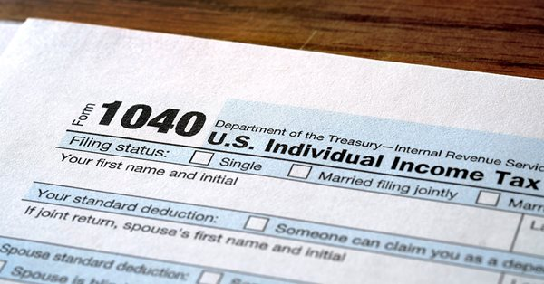 Close up of the top of a paper 1040 tax form